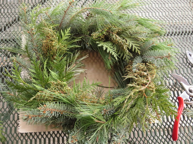 Spruce, cedar, pine, and arborvitae boughs added to wreath