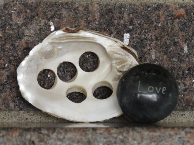 Button shell with Love rock